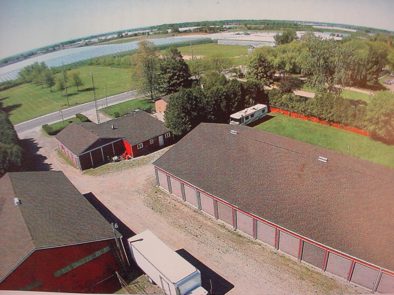 OUTSTANDING INVESTMENT OPPORTUNITY TURN-KEY MINI-STORAGE BUSINESS ON 3.795 ACRES; 3-BUILDINGS PLUS HOUSE Image